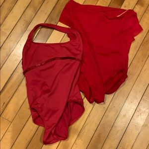 Two red ballet leotards.